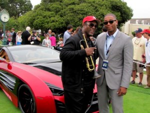 picture of Jon Barnes and Marc D. Johnnson, Laraki exhibit with his carbon made trumpet and a $2 million dollar carbon fiber made Laraki behind them, Concours d' Elegance