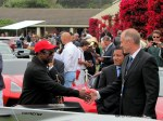 MAYO Communications with Jazz Musician Jon Barnes shakes hands with Thomas Brinkman, Lamborghini, USA at the exclusive exhibit area at Pebble Beach Concours.