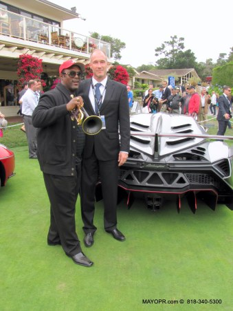 MAYOCommunications.com with  Jon Barnes posed for a picture with Thomas Brinkman, Reg. Mgr., US, N. Region, Automobili Lamborghini America, LLC. at the Pebble Beach Concours D' Elegance.