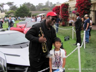 Jon Barnes at the Lamborghini Exhibit poses with a visitor at the Concours D' Elegance, Pebble Beach, CA.