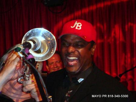 Arturo plays trumpet while jon barnes looks on